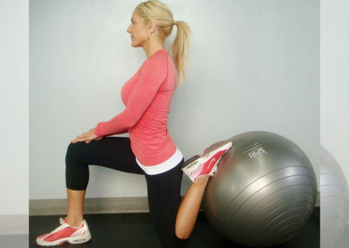 Stretch quad half kneeling