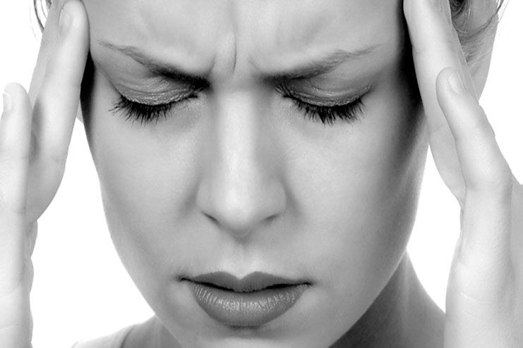 causes of headache behind eyes