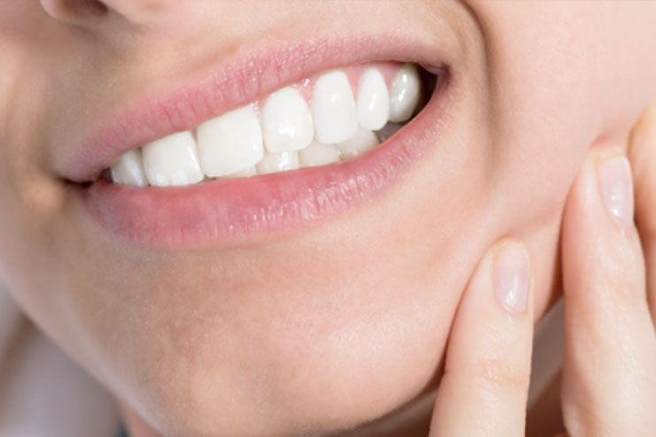 Check for signs of bruxism