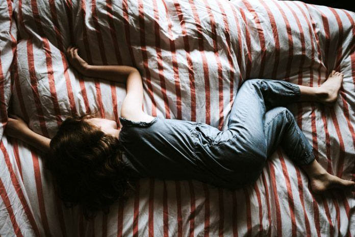reasons sleeping on your stomach is bad